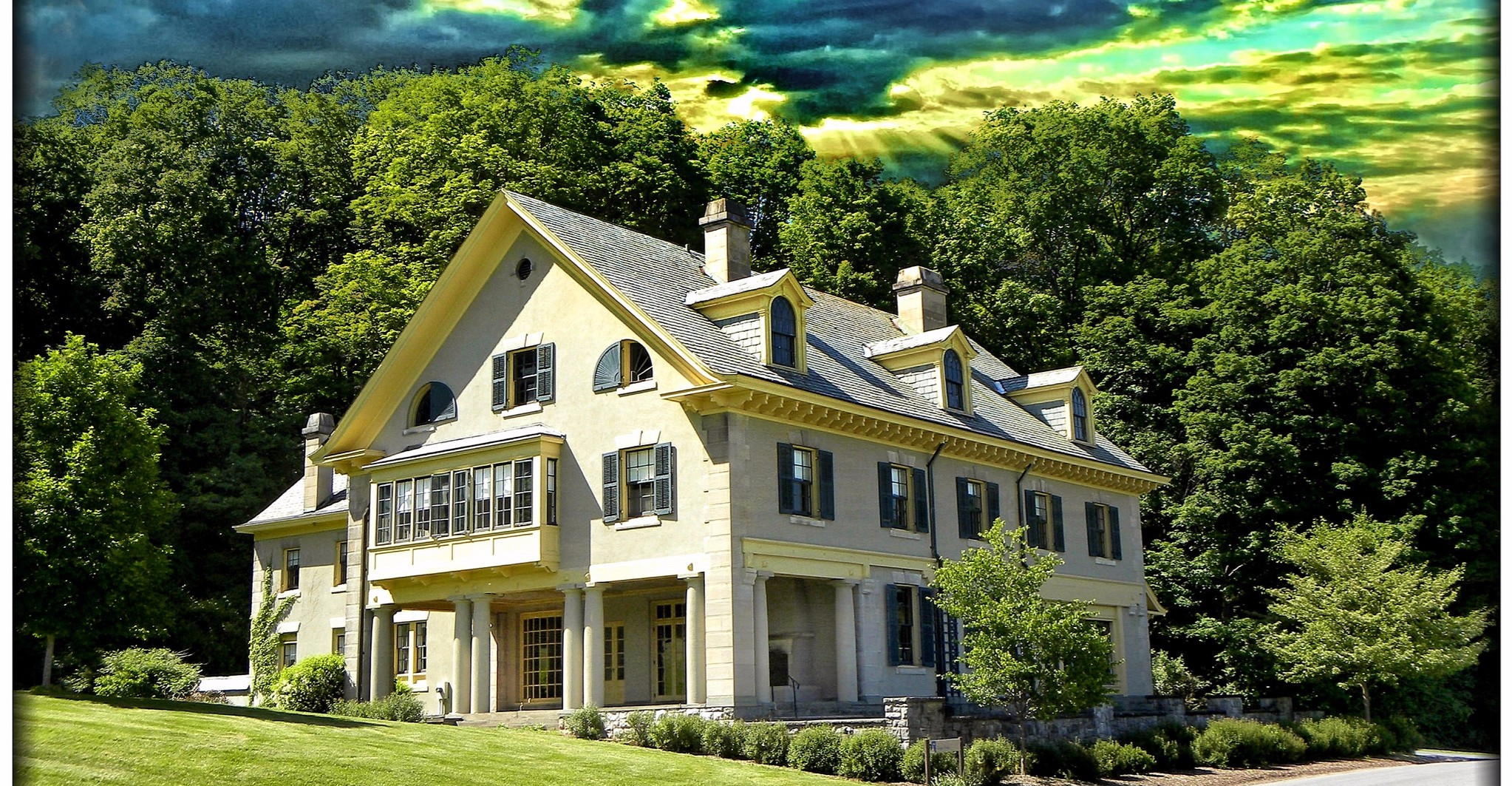 Estate planning - mansion against trees and sky