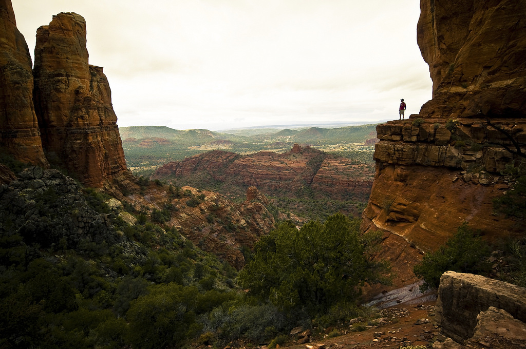 Nature: The Natural Stress Reliever - Phelps Law Office, PLC - person standing on ledge jutting out over canyon