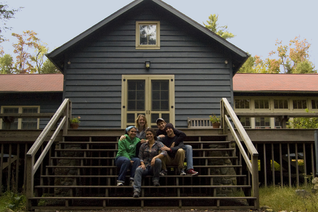 3 Ways to Pass on the Family Cabin - group of people sitting outside a cabin