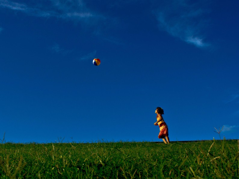 trusts, wills, estate planning - child on grass with ball in air
