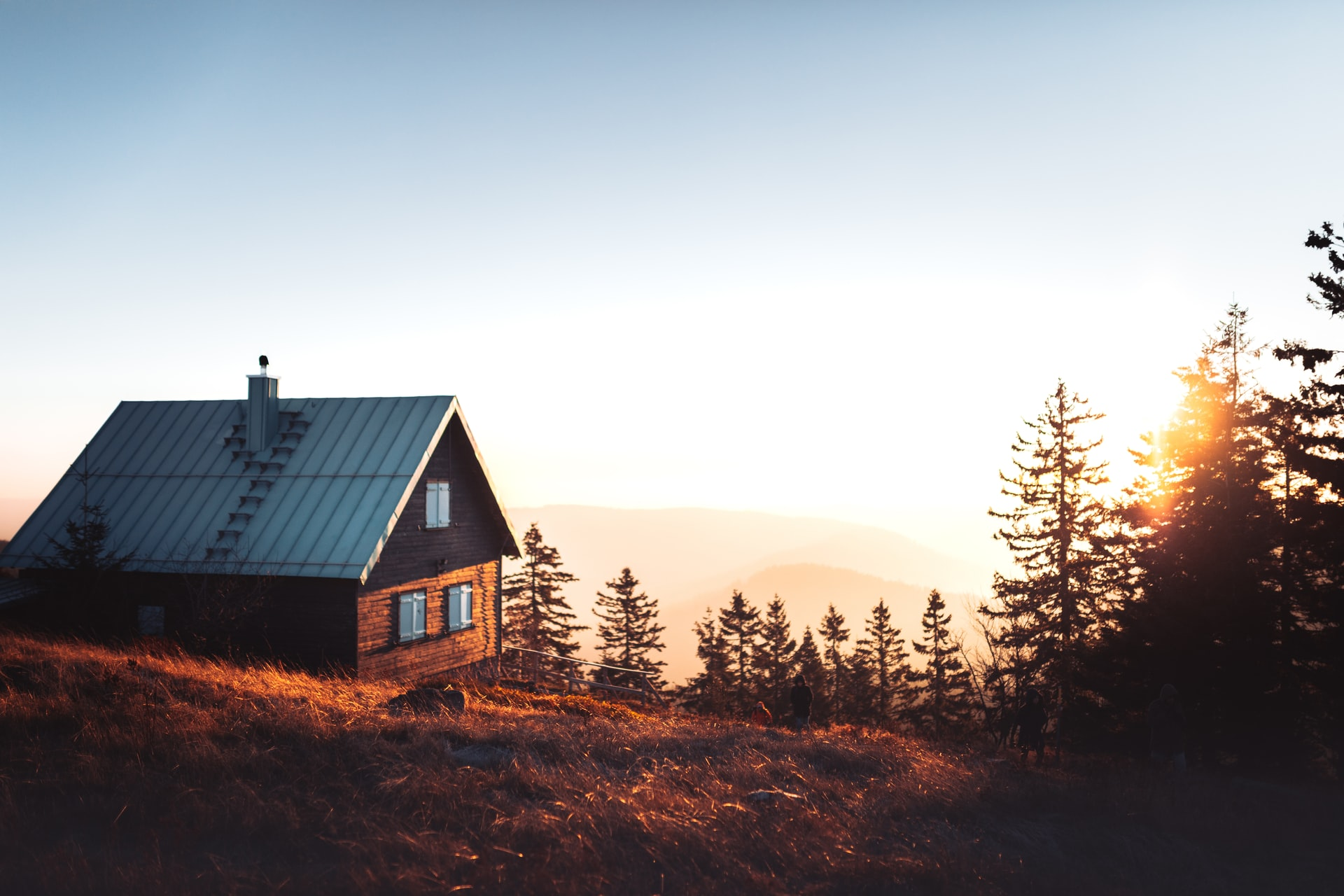 family cabin trust - cabin in woods at sunset