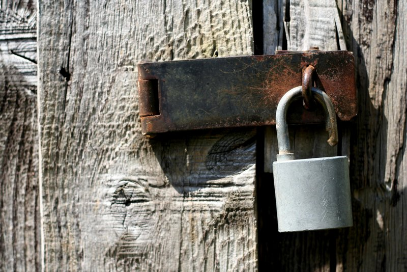 Is Your Estate Plan Vulnerable to Being Attacked? - opened lock on a wooden door latch