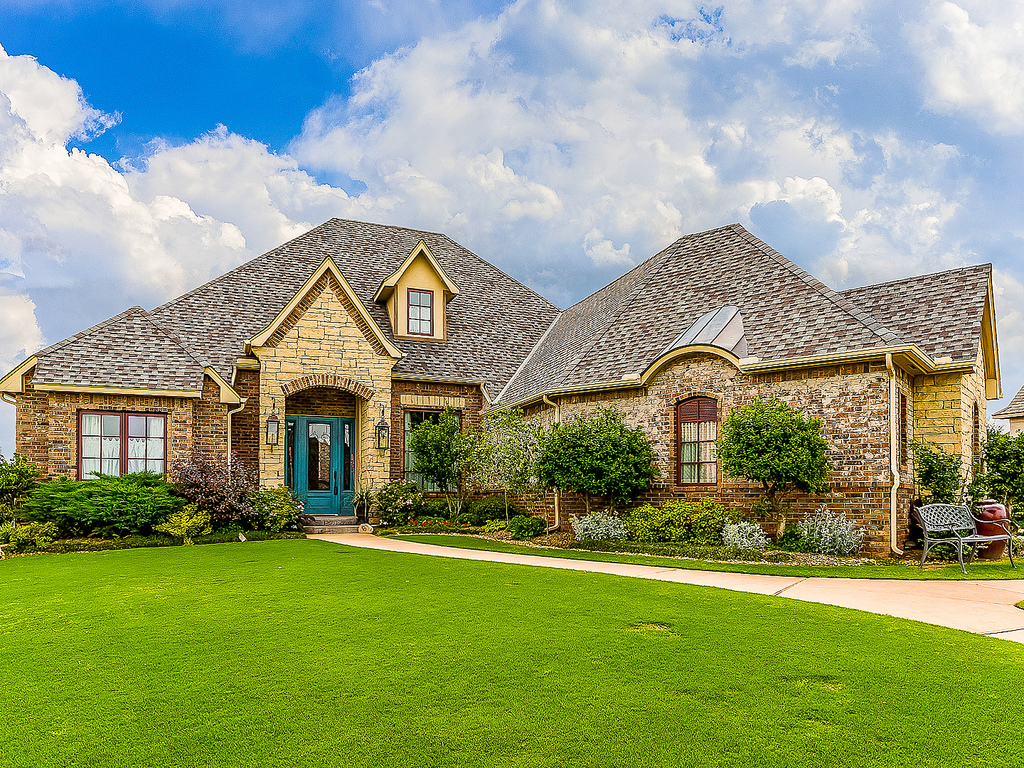 estate planning - view of large house with green lawn