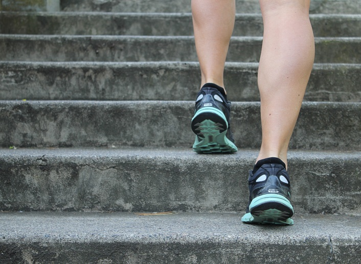benefits of exercise blog - legs with sneakers walking up