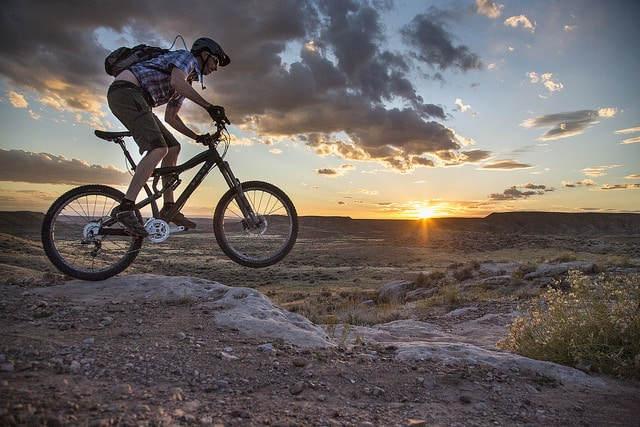 person on mountain bicycle on uneven terrain