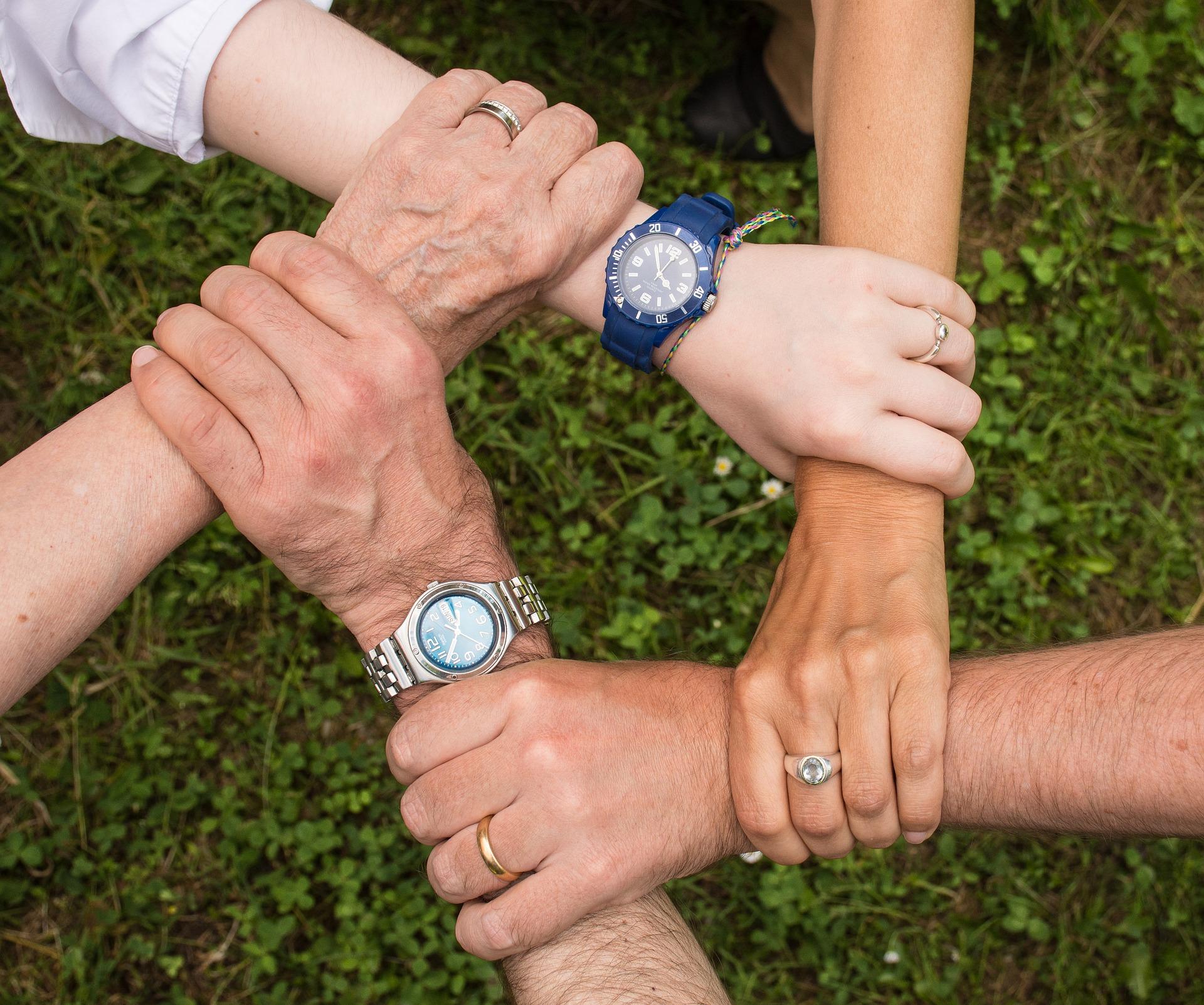 IRA Inheritance Trust - five hands holding each other