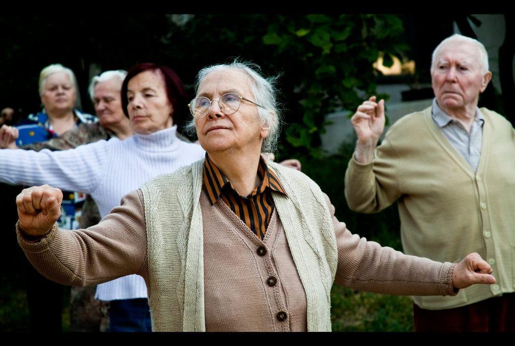 Elder Law Phoenix Chandler Scottsdale AZ - group of people stretching hands outdoors