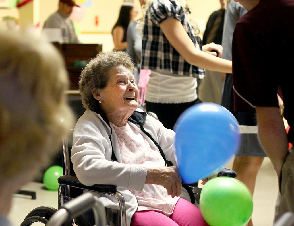 Wills and Trusts - person sitting on wheelchair with balloons