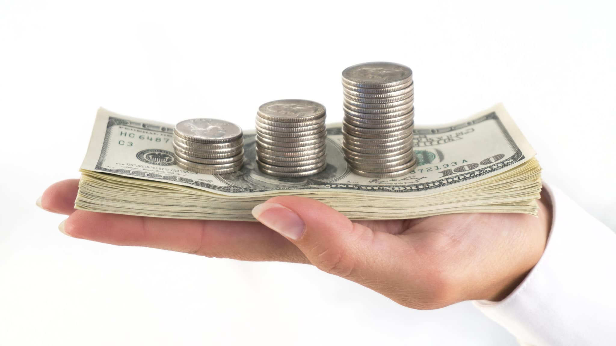 Funding a Living Trust in Phoenix & Scottsdale - palm holding stack of dollar bills and stacks of coins