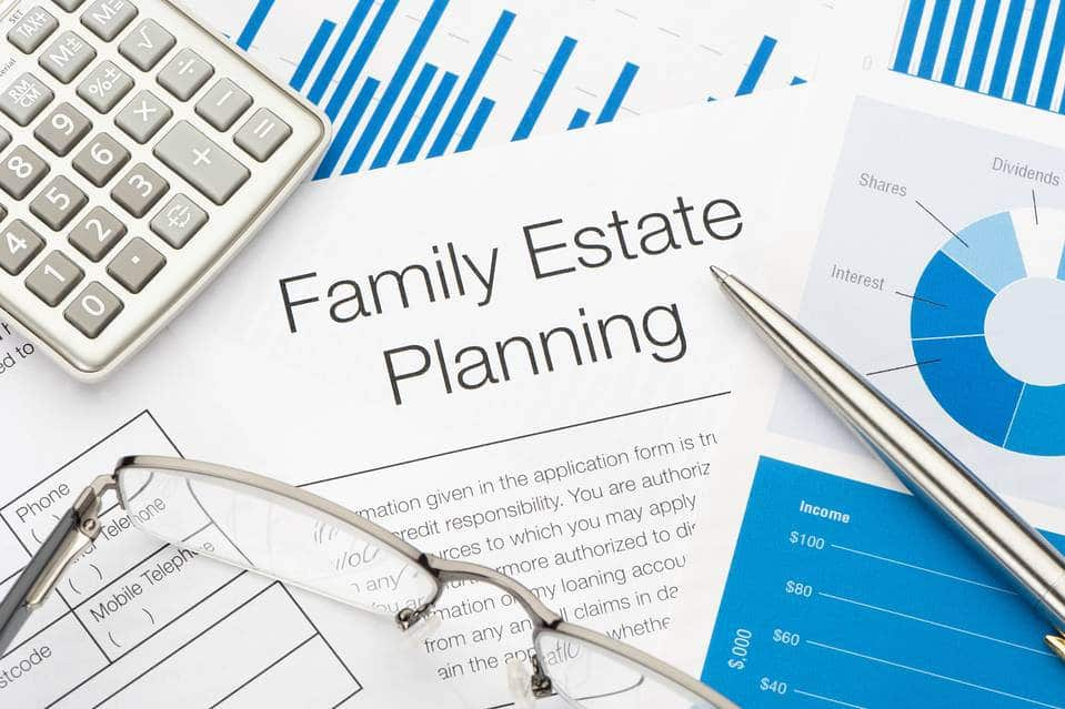 Estate Planning attorneys - estate planning document with glasses, calculator, charts around it