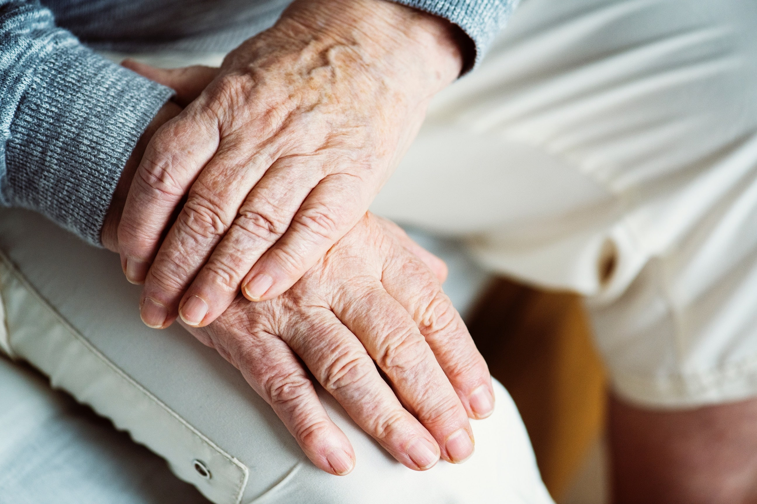 Caretakers of the elderly - person placing hands on thigh