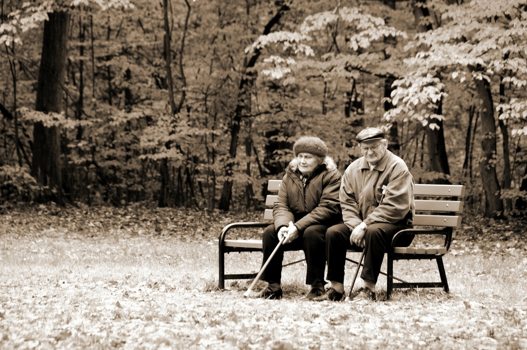 talking to parents about aging - older couple on bench sepia