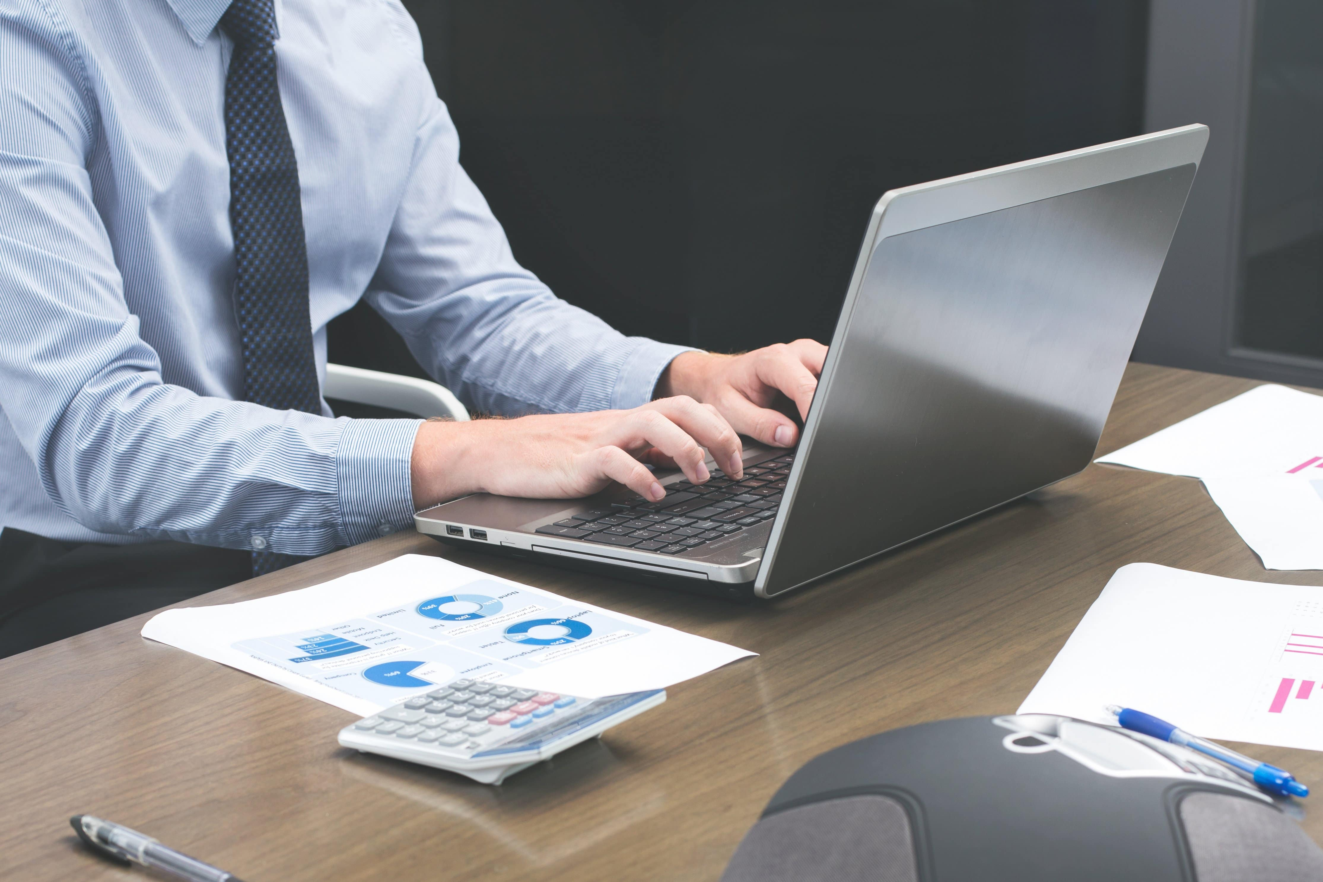 Benefits of Forming an LLC in Arizona - person typing on laptop at desk