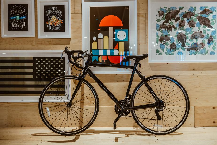 fun things to do in April in Phoenix - bicycle in front of a wall with framed art pieces