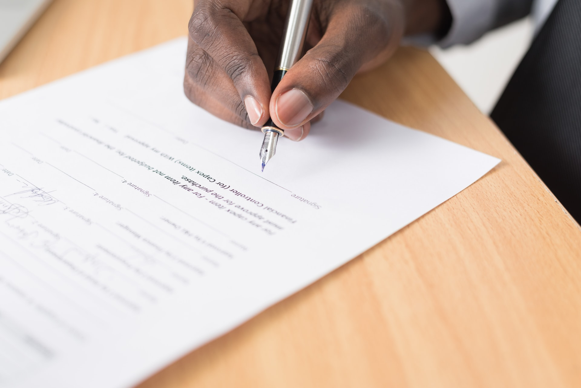 how to dissolve a trust - hand signing legal document