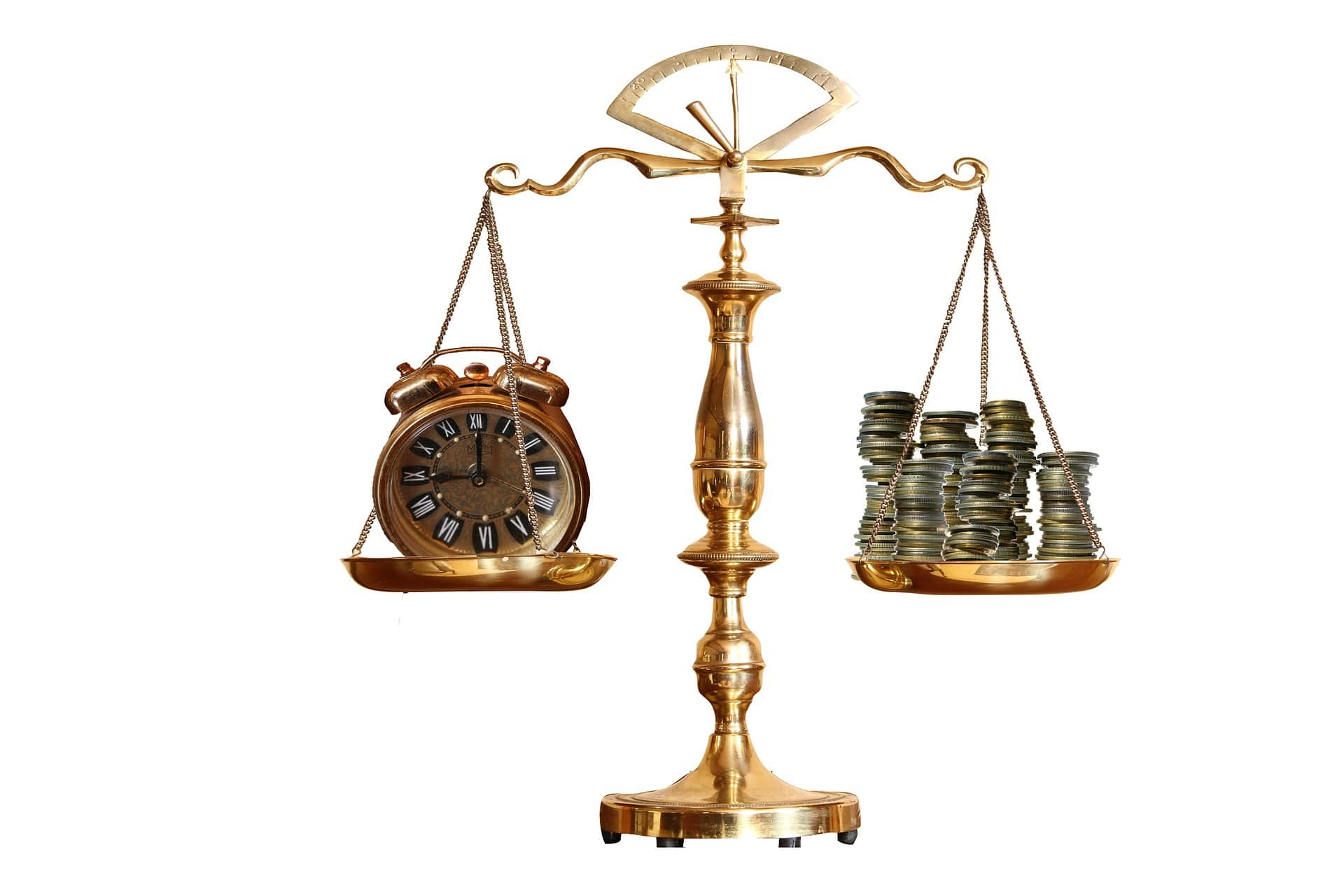 can you dissolve a trust - scales with clock on one side and money on other side