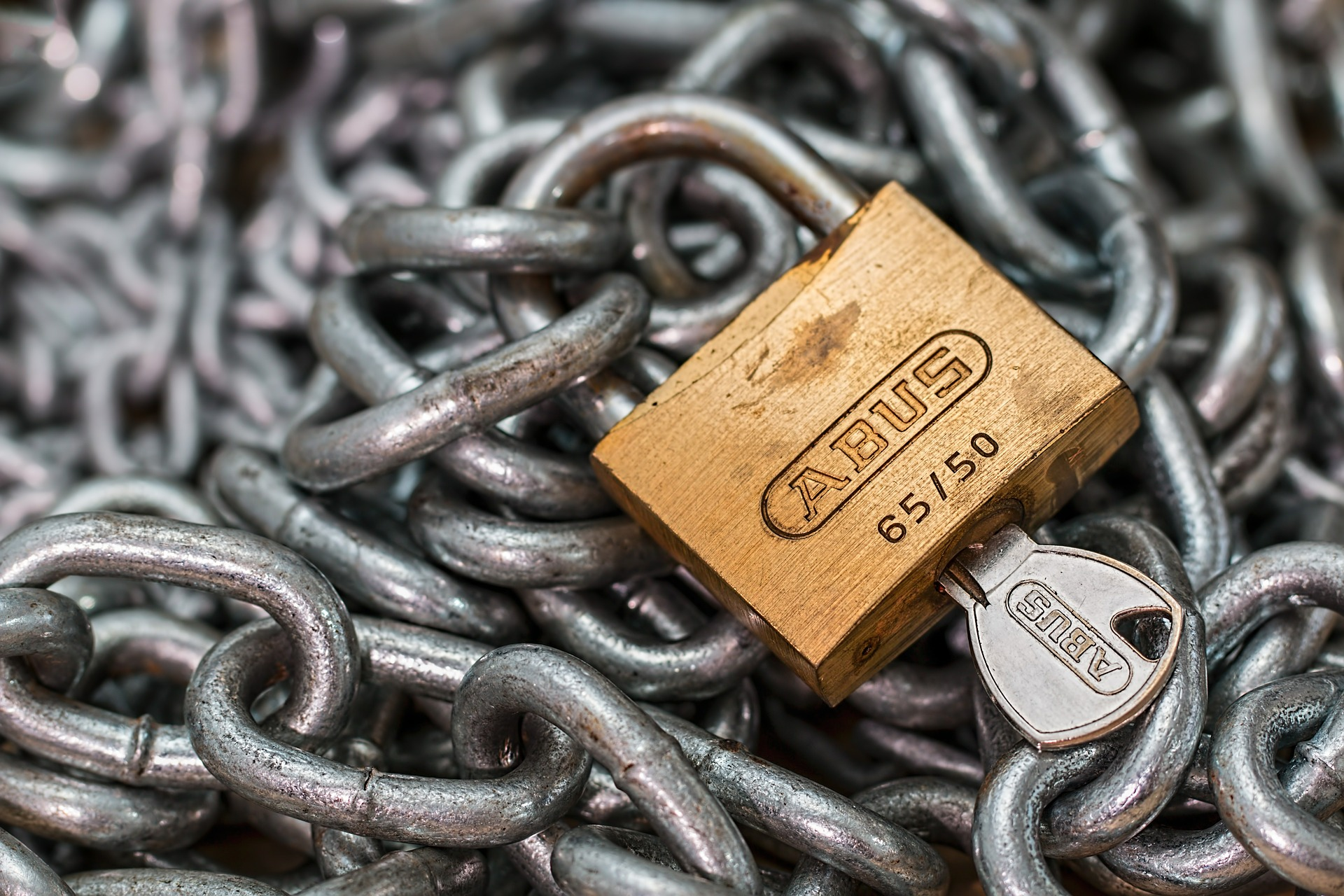 Advantages & Disadvantages of an Irrevocable Trust - lock and key on a bed of chains
