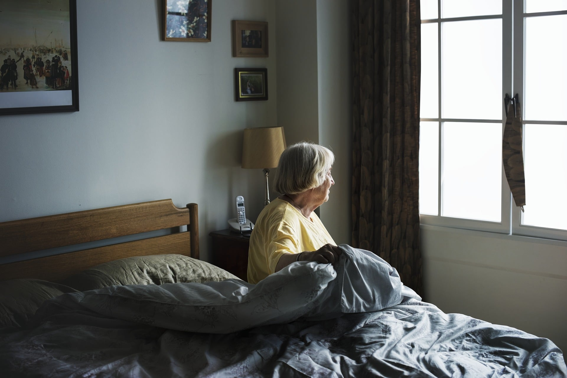 can't pay for nursing home care costs - elderly women getting out of bed